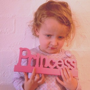 My three-year-old daughter posing with her princess sign